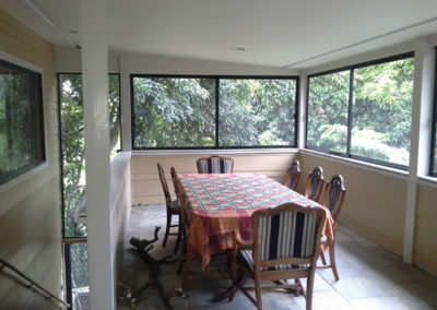 Lanai enclosure outdoor dining area.