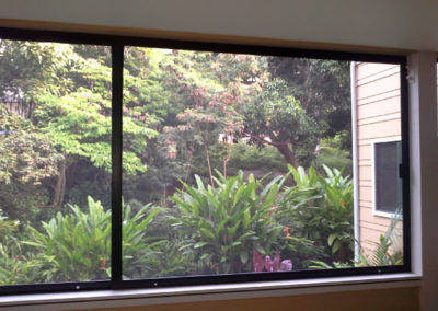 Custom extra wide sliding screen doors for lanai enclosure.