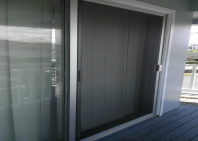 Silver sliding screed door.
