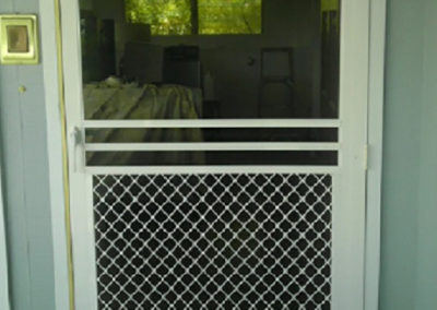 Half grill swing screen door.