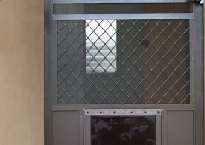 Santa Fe swing door with pet door.